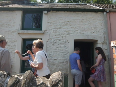 Visitors outside the 1955 house bring the whole place to life