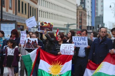 Kurdish families demonstrating in queen street seeking help from Uk government to prevent the genocide of their people fighting against ISIS