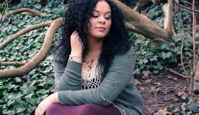 aleighica scott sitting in the woods