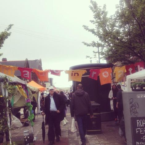 Made in Roath bunting banner across a busy street