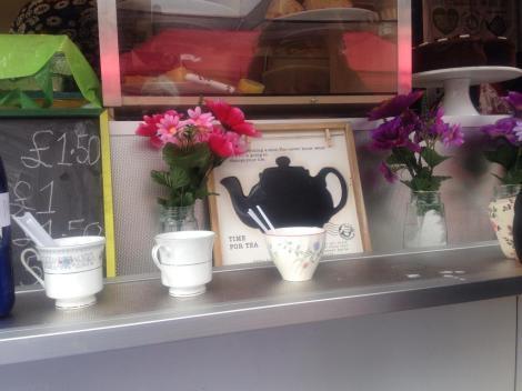 teacups on the shelf of a food truck