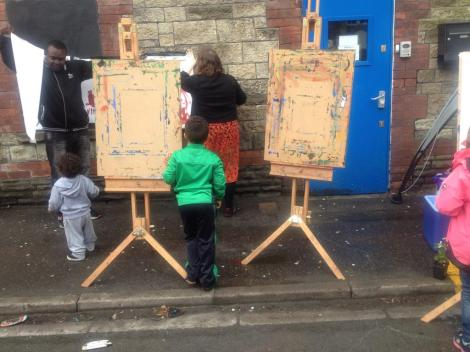 noticeboards for drawing on the side of a street