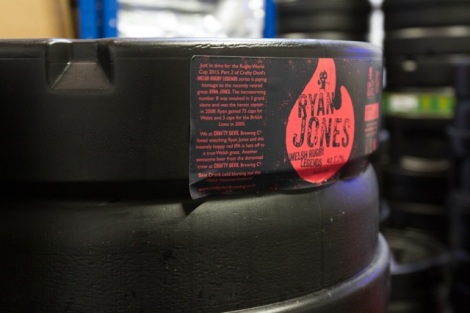 """Cardiff, United Kingdom, November 26 2015. Stacked barrels of """"Ryan Jones - Welsh Rugby Legends"""" beer at the Crafty Devil Brewery site, Canton, Cardiff, Wales."""