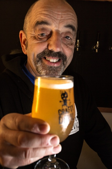 Cardiff, United Kingdom, November 26 2015. Storekeeper Gareth serves up a pint at the Crafty Devil's Cellar bar.