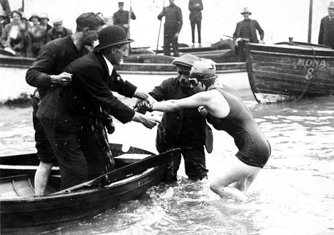 Kathleen Thomas Penarth swimmer climbing into a boat